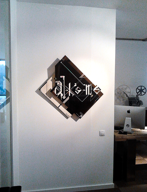 NO CURVES interprets THE ALKEME COMPANY logo. A Tape, Wood + Plexiglass 3D Sculpture that create illusion with shadows (2)